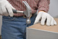Assembling the chest man wooden selective focus on nail Royalty Free Stock Photos
