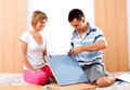 Assembling furniture happy couple is Royalty Free Stock Images