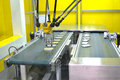 Assembly line industrial robot arm on Royalty Free Stock Image