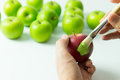 Assimilation or integration concept of by painting red apple into green color Stock Images