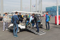 Assistance for the disabled sochi russia mar olympic park young man helps in wheelchairs to enter electric car is equipped people Royalty Free Stock Photos