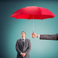 Assistance hand cheerful businessman under an umbrella Stock Photography