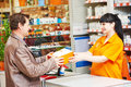 Assistant cashier works with buyer shop female seller selling lamp to purchaser in hardware shopping mall supermarket Royalty Free Stock Image