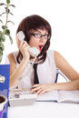 Assistant receiving some shocking news on phone woman isolated white Royalty Free Stock Photography