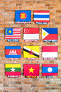 Association of southeast asian nations flags arrange beside the brick wall Royalty Free Stock Photography