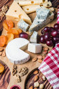 Assorted cheeses with grapes and nuts Royalty Free Stock Photo