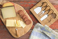 Assorted cheeses and spicy sausage overhead view of a cheeseboard with including havarti manchego gouda served with sliced on a Stock Photography