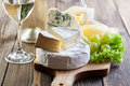 Assorted cheeses on wooden board Royalty Free Stock Images