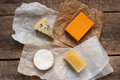 Assorted cheeses on the wooden table sbrinz camembert cheddar blueshatel Stock Photography