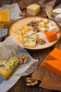 Assorted cheeses on the wooden table Royalty Free Stock Photo