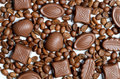 Assorted chocolate candy on the background of coffee beans isola Royalty Free Stock Photo