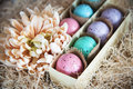 Assorted colorful painted easter eggs in a gift box