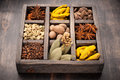 Assorted colorful spices in vintage old wooden box Stock Photo