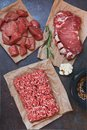 Assorted cuts of raw angus beef meat on parchment paper Royalty Free Stock Photo