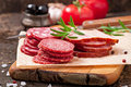 Assorted deli meats and rosemary Royalty Free Stock Photo