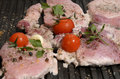 Assorted delicious grilled meat with vegetable over the coals on a barbecue in closeup