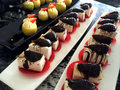 Assorted deserts and mini cakes served on the plates at the buffet Stock Image
