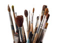 Assorted dirty old painting brushes isolated on white Stock Photos