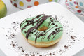 Assorted donut sweet with a sprinkling of brown and green colors are very tasty Stock Photos