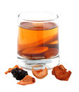 Assorted dried fruit compote in a glass on a white background. Royalty Free Stock Photo