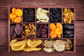 Assorted  dried fruits in wooden box Royalty Free Stock Photo