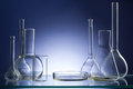 Assorted empty laboratory glassware, test-tubes. Blue tone medical background. Copy space Royalty Free Stock Photo