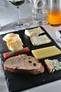 Assorted fine cheese plate with bread Royalty Free Stock Image