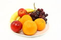 Assorted Fresh Fruits On A White Plate Stock Photography