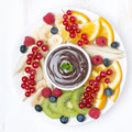 Assorted fruit with chocolate sauce top view close up Stock Photos