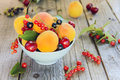 Assorted fruits and berries apricots cherry black red currant Royalty Free Stock Photography