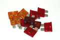 Assorted fuses as used in the automotive industry Stock Photo