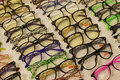 Assorted glasses at apparel and accessory shop.    Cheap apparel Royalty Free Stock Photo