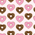 Assorted heart shaped doughnuts glazed with chocolate and pink icing topped with colourful sprinkles arranged in a seamless Royalty Free Stock Photography
