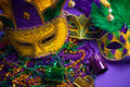 Assorted Mardi Gras or Carnivale mask on a purple  Royalty Free Stock Photos