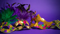 Assorted Mardi Gras or Carnivale mask on a purple background Royalty Free Stock Image