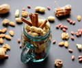 Assorted mixed nuts in a glass jar, peanuts, almonds, walnuts and sesame seeds Royalty Free Stock Photo