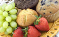 Assorted Muffins with Fresh Fruit Royalty Free Stock Image