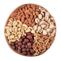 Assorted nuts in a wicker bowl on white background Stock Photos