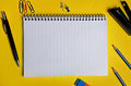 Assorted office supplies on yellow background Stock Image