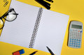 Assorted office supplies on yellow background Royalty Free Stock Photo