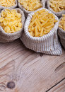 Assorted pasta in burlap bags Stock Photo