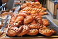 Assorted pastries assortment of and croissant displayed in a store Royalty Free Stock Image