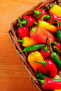 Assorted peppers in basket Royalty Free Stock Photo