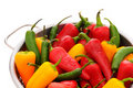 Assorted peppers in colander Royalty Free Stock Photo