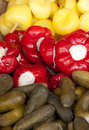 Assorted pickles cucumbers red and yellow peppers Stock Photography