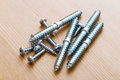 Assorted screws on the wooden background Royalty Free Stock Images