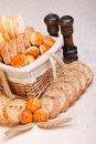 Assorted sliced bakery products and wheat Royalty Free Stock Photo