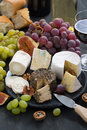 Assorted soft delicacy cheeses and appetizers to wine top view vertical close up Stock Images