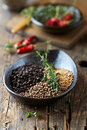 Assorted spices and fresh thyme in a ceramic dish Royalty Free Stock Images