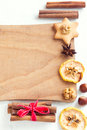 Assorted spices, nuts on cutting board Royalty Free Stock Photo